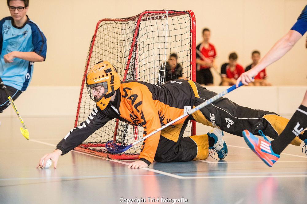 Keeper saves the ball during a Floorball game