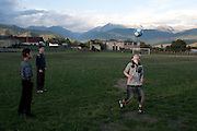 Students of the Roddy Scott Foundation play football behind there Duisi classroom, with Greater Caucasus Mountain Range in the backdrop. Republic of Georgia.