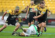 Hurricanes' Dane Coles beats the tackle of Highlanders' Ash Dixon during the Round 14 Super Rugby match, Hurricanes v Highlanders at Westpac Stadium, Wellington. 27th May 2016. Copyright Photo.: Grant Down / www.photosport.nz