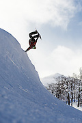 Alex Yoder does an andrecht (backside handplant) on a man-made bank at Hanazono resort, Niseko, Hokkaido, Japan. He is riding a Gentemstick Rocketfish, a 144cm swallowtail--not an ordinary freestyle board. This was our first day on-snow, and introduced me to the Gentemstick philosophy of riding everything with equal commitment, whether hard snow, powder snow, or otherwise.