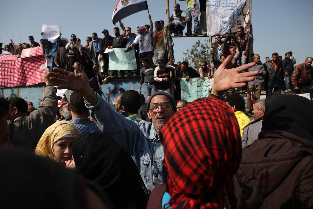 People chant against Hosni Mubarak's regime.