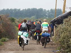 "© Licensed to London News Pictures. 30/08/2015. Calais, France. Around a hundred British cyclists from ""Critical mass to Calais"" arrive to Calais from London as they are to donate bicycles to the people in the refugee camp, also known as the Jungle, as well as supplies to support the life at the site. Photo credit : Isabel Infantes/LNP"