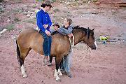 "Aug 9, 2008 -- COLORADO CITY, AZ: Members of the Jessop family in Colorado City, AZ. The Jessops are polygamist members of the FLDS. Colorado City and neighboring town of Hildale, UT, are home to the Fundamentalist Church of Jesus Christ of Latter Day Saints (FLDS) which split from the mainstream Church of Jesus Christ of Latter Day Saints (Mormons) after the Mormons banned plural marriage (polygamy) in 1890 so that Utah could gain statehood into the United States. The FLDS Prophet (leader), Warren Jeffs, has been convicted in Utah of ""rape as an accomplice"" for arranging the marriage of teenage girl to her cousin and is currently on trial for similar, those less serious, charges in Arizona. After Texas child protection authorities raided the Yearning for Zion Ranch, (the FLDS compound in Eldorado, TX) many members of the FLDS community in Colorado City/Hildale fear either Arizona or Utah authorities could raid their homes in the same way. Older members of the community still remember the Short Creek Raid of 1953 when Arizona authorities using National Guard troops, raided the community, arresting the men and placing women and children in ""protective"" custody. After two years in foster care, the women and children returned to their homes. After the raid, the FLDS Church eliminated any connection to the ""Short Creek raid"" by renaming their town Colorado City in Arizona and Hildale in Utah. A member of the Jessop family weeds the community corn plot in Colorado City, AZ. The Jessops are a polygamous family and members of the FLDS. Photo by Jack Kurtz / ZUMA Press"