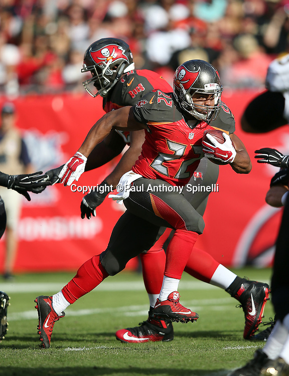 Tampa Bay Buccaneers running back Doug Martin (22) runs for a 22 yard gain in the third quarter during the 2015 week 14 regular season NFL football game against the New Orleans Saints on Sunday, Dec. 13, 2015 in Tampa, Fla. The Saints won the game 24-17. (©Paul Anthony Spinelli)