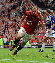 Wayne Rooney celebrates scoring the first goal during the Barclays Premier League match between Manchester United and Birmingham City at Old Trafford on August 16, 2009 in Manchester, England.