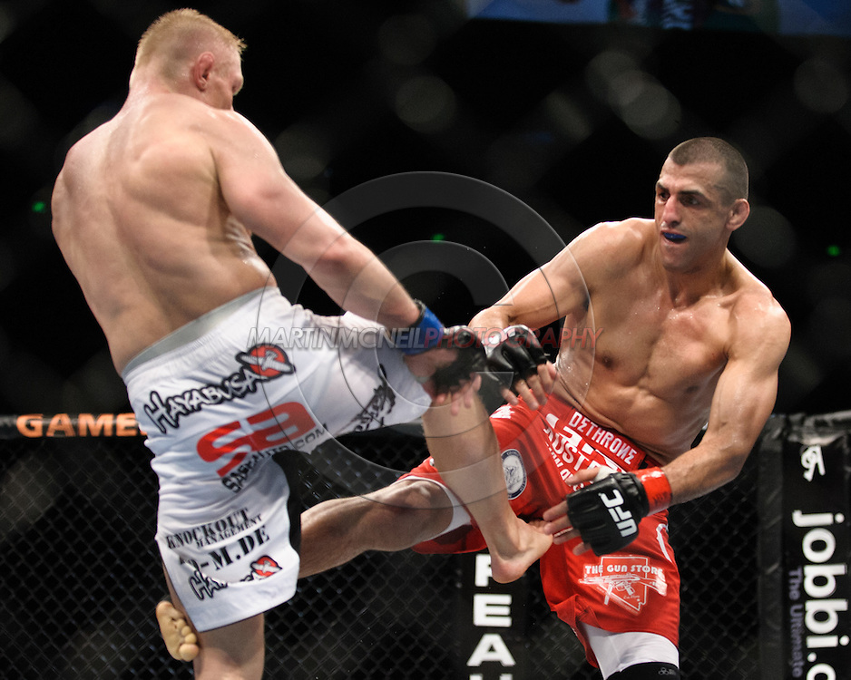 "SYDNEY, AUSTRALIA, FEBRUARY 27, 2011: Dennis Siver (left) and George Sotiropoulos trade blows during ""UFC 127: Penn vs. Fitch"" inside Acer Arena in Sydney, Australia on February 27, 2011."