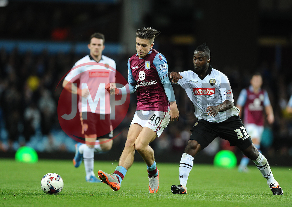 Jack Grealish of Aston Villa battles for the ball with Stanley Aborah of Notts County  - Mandatory byline: Joe Meredith/JMP - 07966386802 - 25/08/2015 - FOOTBALL - Villa Park -Birmingham,England - Aston Villa v Notts County - Capital One Cup - Second Round