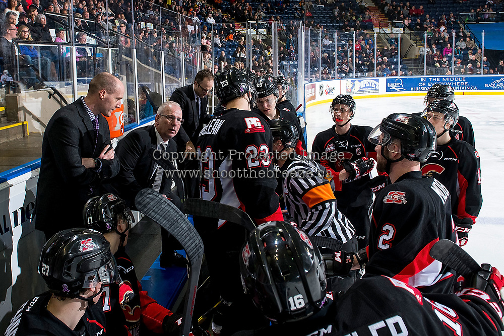 KELOWNA, BC - FEBRUARY 08: Prince George Cougars' GM Mark Lamb stands on the bench as interim head coach and speaks to the referee during a time out against the Kelowna Rockets at Prospera Place on February 8, 2019 in Kelowna, Canada. (Photo by Marissa Baecker/Getty Images)