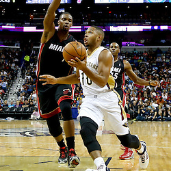 Oct 23, 2013; New Orleans, LA, USA; New Orleans Pelicans shooting guard Eric Gordon (10) drives past Miami Heat power forward Chris Bosh (1) during the first half of a preseason game at New Orleans Arena. Mandatory Credit: Derick E. Hingle-USA TODAY Sports