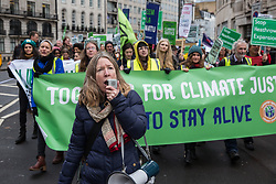 London, UK. 1st December, 2018. Environmental campaigners pass the BBC's New Broadcasting House on the Together for Climate Justice demonstration in protest against Government policies in relation to climate change, including Heathrow expansion and fracking. Following a rally outside the Polish embassy, chosen to highlight the UN's Katowice Climate Change Conference which begins tomorrow, protesters marched to Downing Street.
