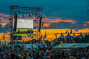 Sunset over the Pyramid Arena and the John Peel tent - The 2016 Glastonbury Festival, Worthy Farm, Glastonbury.