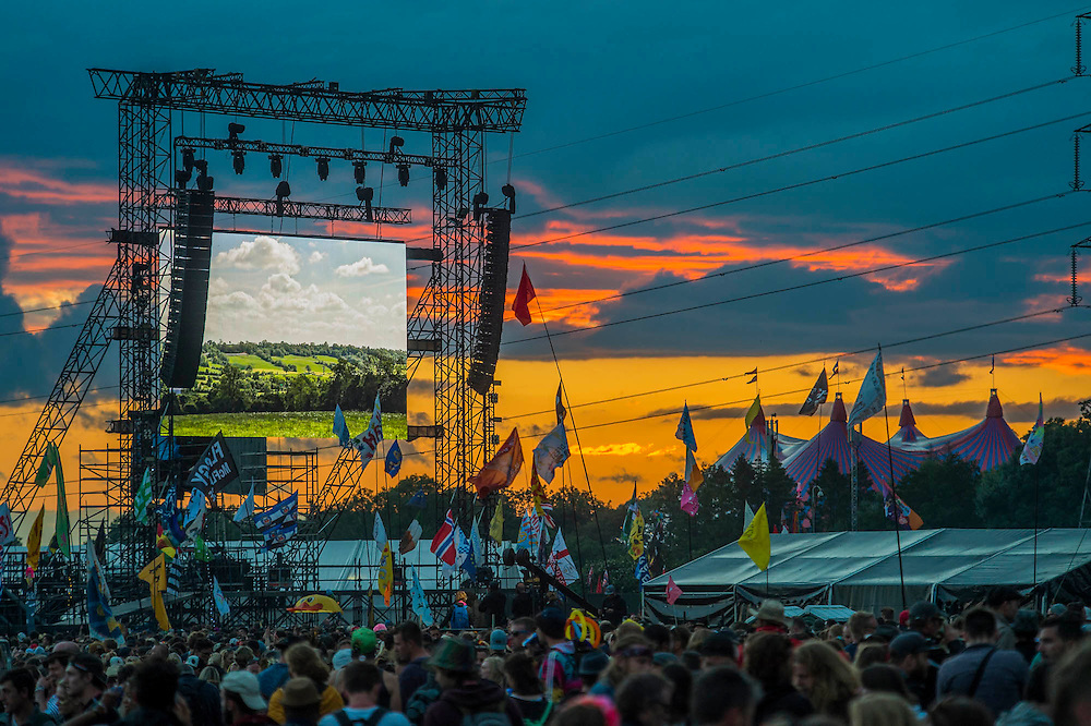 Sunset over the Pyramid Arena and the John Peel tent - The 2016 Glastonbury Festival, Worthy Farm, Glastonbury.