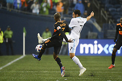 October 8, 2018 - Seattle, Washington, U.S - Seattle's CRISTIAN ROLDAN (7) and Houston's DAMARCUS BEASLEY (7) battle for a loose ball as the Houston Dynamo visits the Seattle Sounders in a MLS match at Century Link Field in Seattle, WA. (Credit Image: © Jeff Halstead/ZUMA Wire)