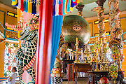"29 MARCH 2012 - TAY NINH, VIETNAM:  The all seeing eye in the Cao Dai Holy See in Tay Ninh, Vietnam. Cao Dai (also Caodaiism) is a syncretistic, monotheistic religion, officially established in the city of Tây Ninh, southern Vietnam in 1926. Cao means ""high"" and ""Dai"" means ""dais"" (as in a platform or altar raised above the surrounding level to give prominence to the person on it). Estimates of Cao Dai adherents in Vietnam vary, but most sources give two to three million, but there may be up to six million. An additional 30,000 Vietnamese exiles, in the United States, Europe, and Australia are Cao Dai followers. During the Vietnam's wars from 1945-1975, members of Cao Dai were active in political and military struggles, both against French colonial forces and Prime Minister Ngo Dinh Diem of South Vietnam. Their opposition to the communist forces until 1975 was a factor in their repression after the fall of Saigon in 1975, when the incoming communist government proscribed the practice of Cao Dai. In 1997, the Cao Dai was granted legal recognition. Cao Dai's pantheon of saints includes such diverse figures as the Buddha, Confucius, Jesus Christ, Muhammad, Pericles, Julius Caesar, Joan of Arc, Victor Hugo, and the Chinese revolutionary leader Sun Yat-sen. These are honored at Cao Dai temples, along with ancestors.    Photo by Jack Kurtz / ZUMA Press  PHOTO BY JACK KURTZ"