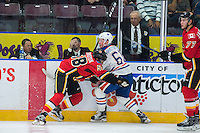 PENTICTON, CANADA - SEPTEMBER 17: Oliver Kylington #58 of Calgary Flames checks Braden Christoffer #61 of Edmonton Oilers on September 17, 2016 at the South Okanagan Event Centre in Penticton, British Columbia, Canada.  (Photo by Marissa Baecker/Shoot the Breeze)  *** Local Caption *** Braden Christoffer; Oliver Kylington;