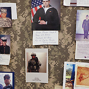 JUNE 28, 2016 --- COROZAL, PUERTO RICO<br /> A bulletin board in the break room of Bluewater Defense decorated with portraits of relatives of employees who serve or have served in the US armed forces. The company makes pants for the US Army.<br /> (Photo by Angel Valentin/Freelance)