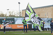 Flag bearer during the EFL Sky Bet League 2 match between Forest Green Rovers and Walsall at the New Lawn, Forest Green, United Kingdom on 8 February 2020.