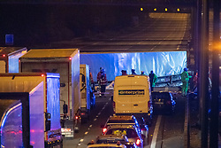 © Licensed to London News Pictures. 01/04/2020. Gerrards Cross, UK. An overturned HGV on the northbound carriageway of the M40 motorway between junction 1 and junction 2. The M40 motorway was closed in both directions due to a Road Traffic collision involving a heavy goods vehicle and at least to cars. Photo credit: Peter Manning/LNP