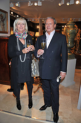 ALEX SANDBERG and SARA PEARSON at a preview evening of the annual London LAPADA (The Association of Art & Antiques Dealers) antiques Fair held in Berkeley Square, London on 20th September 2011.