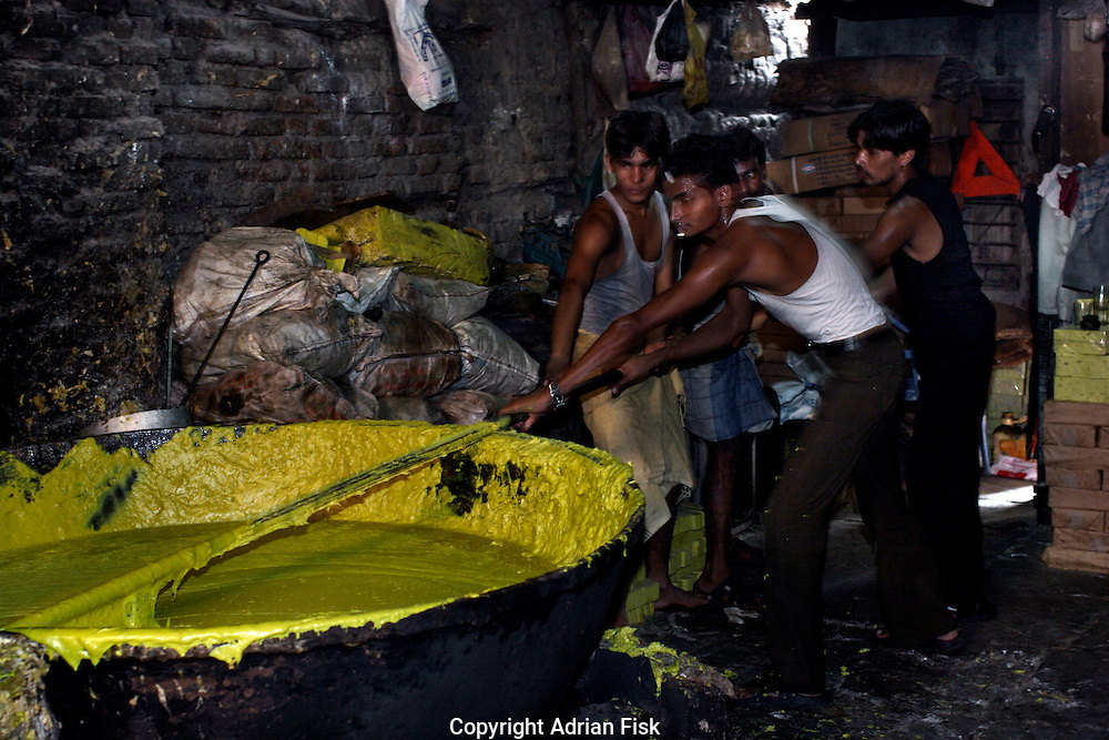 Men stir a huge vat of boiling soap on 21st Oct 2006. The men spend all day stirring the soap in a backwards forwards motion in order to stop it from sticking to the vat. The soap is collected from old hotels, melted then recaked and sold on.