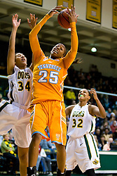 December 22, 2009; San Francisco, CA, USA;  Tennessee Lady Volunteers forward Glory Johnson (25) grabs a rebound from San Francisco Dons forward Whitney Daniels (34) during the first half at War Memorial Gym.  Tennessee defeated San Francisco 89-34.