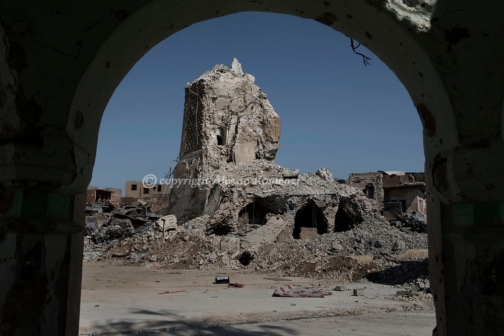 IRAQ, Mosul: What it remain of the minaret of the historical Great Al-Nuri mosque were in 2014 Al Bagdadi declared himself as calif of the newly established Islamic State. Alessio Romenzi