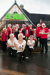 Text Santa  Charity Campaign Launch People Manager Sue Stringer with Asda collueuages Barrow Road Asda Harrogate. .www.pauldaviddrabble.co.uk.6 December 2011  Image © Paul David Drabble