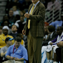Jan 18, 2010; New Orleans, LA, USA; New Orleans Hornets assistant coach Tim Floyd watches from the bench against the San Antonio Spurs at the New Orleans Arena. The Spurs defeated the Hornets 97-90. Mandatory Credit: Derick E. Hingle-US PRESSWIRE