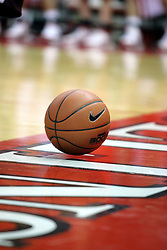 05 January 2008: NCAA certified basketball bounces on the floor under the basket waiting to be put back in play.  The Redbirds of Illinois State took the bite out of the Salukis of Southern Illinois winning the Conference home opener for the 'birds on Doug Collins Court in Redbird Arena in Normal Illinois by a score of 56-47.