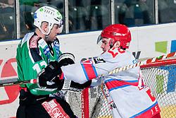 Roughing between Petr Sachl (HDD Tilia Olimpija, #12) and Matevz Erman (HK Acroni Jesenice, #47) during ice-hockey match between HDD Tilia Olimpija and HK Acroni Jesenice in second game of Final at Slovenian National League, on April 3, 2011 at Hala Tivoli, Ljubljana, Slovenia. (Photo By Matic Klansek Velej / Sportida.com)