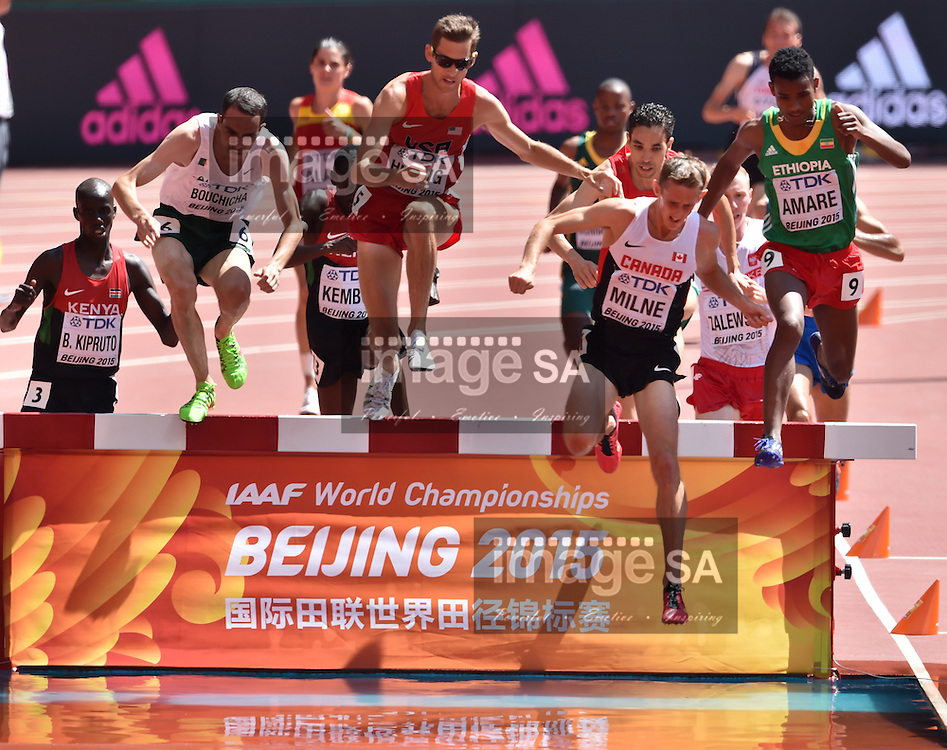 BEIJING, CHINA - AUGUST 22: Brimin Kiprop Kipruto (Kenya), Hicham Bouchicha (Algeria), Daniel Huling (USA), Taylor Milne (Canada) and Hailemariyam Amare (Ethiopia) at the water jump in Round 1 of the mens 3000m steeplechase during day 1 of the 2015 IAAF World Championships at National Stadium on August 22, 2015 in Beijing, China. (Photo by Roger Sedres/Gallo Images)