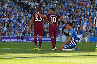 Football - 2017 / 2018 Premier League - Brighton and Hove Albion vs. Manchester City<br /> <br /> Lewis Dunk of Brighton on his knees after scoring an own goal as Gabriel Jesus and Sergio Aguero of Manchester City walk away at The Amex Stadium Brighton <br /> <br /> COLORSPORT/SHAUN BOGGUST