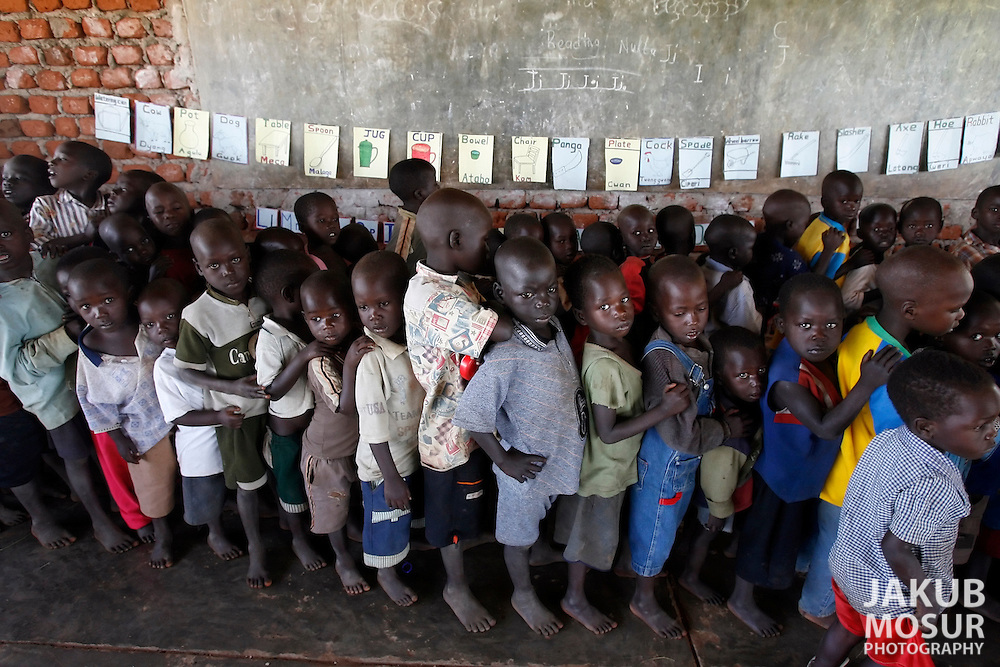 October 6, 2006 - Children stand in line at a day care center in Coope camp for internally displaced people, or IDP, near Gulu in north Uganda. Coope, with a population of 18,000, is one of 76 IDP camps around Gulu, the main base for the Uganda Peoples Defense Force fighting the insurgent Joseph Kony's Lord's Resistance Army. Kony's LRA movement has been fighting for the past 20 years to force the East African country to be ruled according to the Christian Ten Commandments. Over 2 million people, mostly of the Acholi tribe, have moved or were forced to move from their villages to camps close to the towns of Gulu, Lira, and Kitgum where they are watched over by the Ugandan Army. The LRA rebels have abducted thousands of children and have forced them to fight against the Ugandan Army and the Acholi people. Current peace talks between Kony's LRA and the Ugandan government held in Juba, southern Sudan, offer a glimpse of hope to ending this ongoing conflict..(Photo by Jakub Mosur/Polaris)<br />