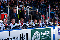 KELOWNA, CANADA - OCTOBER 21: Head coach Mike Johnston stands on the bench next to Associate coach Kyle Gustafson and equipment manager Mark Brennan at the start of the game against the Kelowna Rockets on October 21, 2017 at Prospera Place in Kelowna, British Columbia, Canada.  (Photo by Marissa Baecker/Shoot the Breeze)  *** Local Caption ***