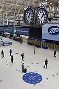 With the UK's Coronavirus pandemic lockdown easing with preparations going ahead for the opening of more public transport and services plus shops, another 151 have died from Covid-19 bringing the total in the last 24hrs to 41,279. Rail passengers make their way through the concourse Waterloo Station while being asked to wear face coverings and to stay apart which is in line with government requirements for all users of public trransport starting next Monday (15th June), on 11th June 2020, in London, England.