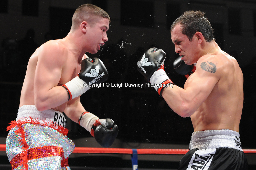 Welterweight Ronnie Heffron (George Cross shorts) defeats Kevin McCauley at York Hall, Bethnal Green, London on the 19th February 2011. Frank Warren Promotions. Photo credit © Leigh Dawney.