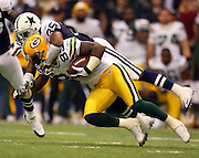 IRVING, TX - NOVEMBER 29: Wide receiver James Jones #89 of the Green Bay Packers catches a pass and gets tackled by cornerback Jacques Reeves #35 of the Dallas Cowboys on November 29, 2007 at Texas Stadium in Irving, Texas. The Cowboys defeated the Packers 37-27. ©Paul Anthony Spinelli *** Local Caption *** James Jones;Jacques Reeves