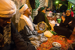 April 25, 2017 - Cairo, Egypt - Egyptian Sufi Muslims celebrate the birth anniversary of Al Sayeda Zainab, grand daughter of Prophet Muhammad, outside the Al Sayeda Zainab Mosque in Cairo, Egypt on April 25, 2017. According to the Sufis the mosque contains the grave of Al Sayeda Zainab. (Credit Image: © Ibrahim Ezzat/NurPhoto via ZUMA Press)