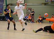 Ross Chisholm scores for Fair City Santos (white) v  Wattcell (blue and yellow) in the Scottish Cup final - Scottish Futsal Finals Day at the DISC<br /> <br />  - &copy; David Young - www.davidyoungphoto.co.uk - email: davidyoungphoto@gmail.com