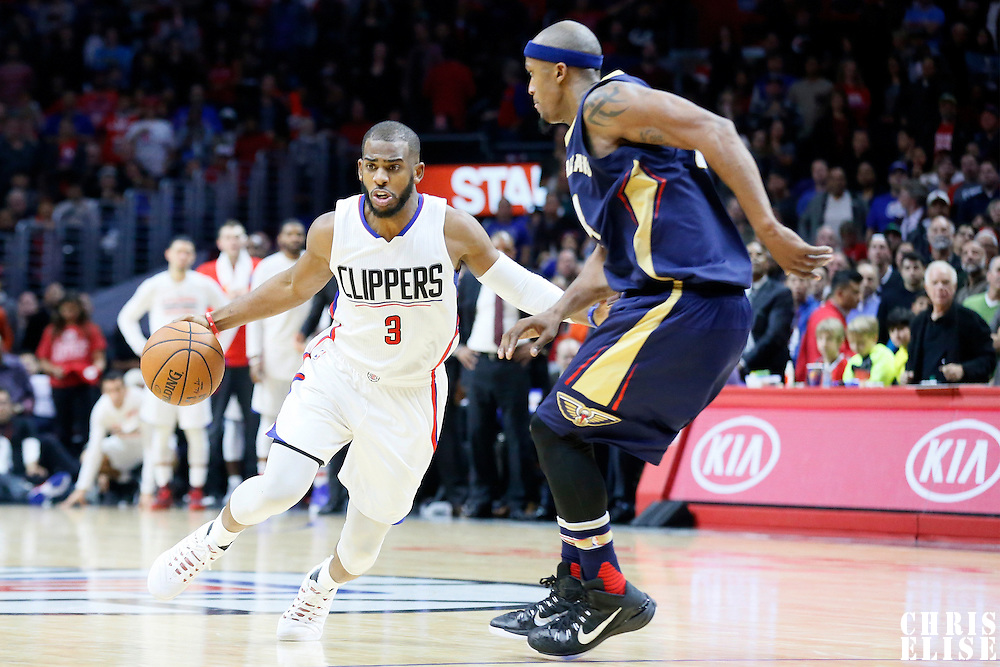 10 January 2016: Los Angeles Clippers guard Chris Paul (3) drives past New Orleans Pelicans forward Dante Cunningham (44) during the Los Angeles Clippers 114-111 overtime victory over the New Orleans Pelicans, at the Staples Center, Los Angeles, California, USA.