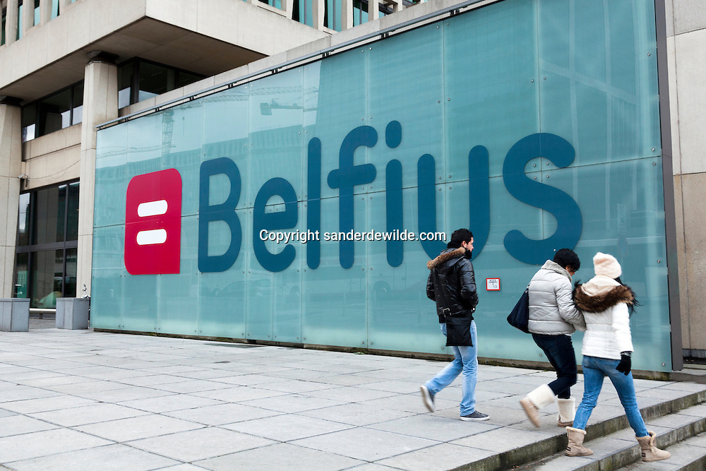 Brussels 15 december 2012 Belfius headquarters, former Dexia bank, with Belfius logo at the entrance. People walking by the Belfius logo at the headquarters in Brussels.