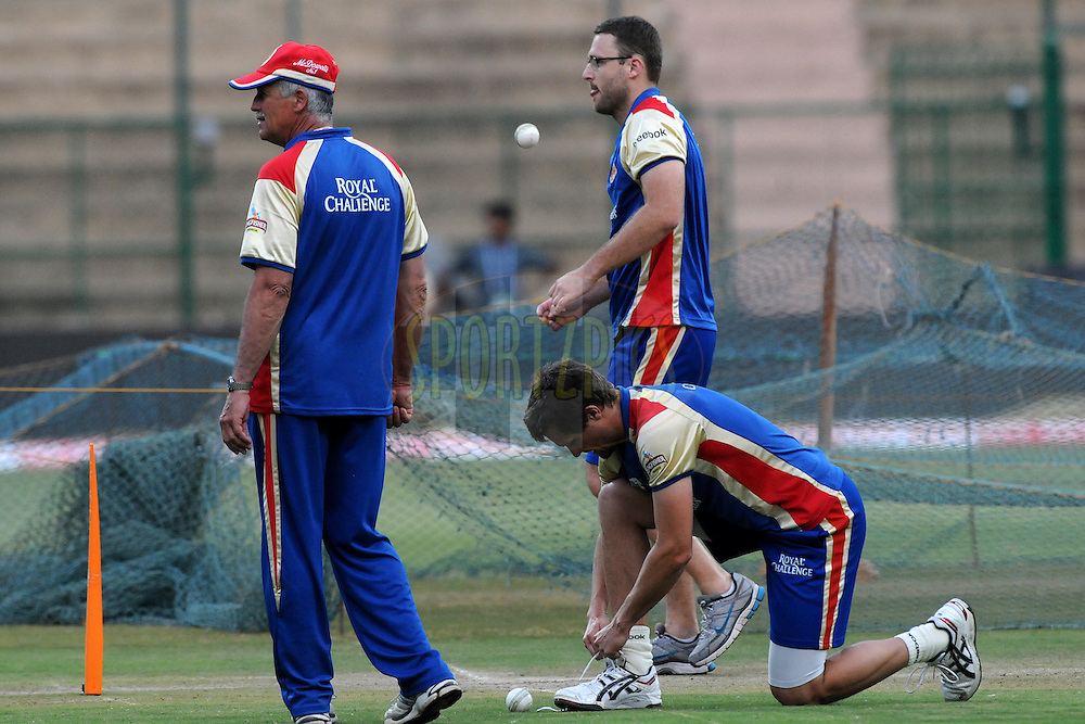 Drik Nanes of Royal Challengers Bangalore, Daniel Vettori of Royal Challengers Bangalore and the coach discuss during the Royal Challengers bangalore training and nets session held at the  M.Chinnaswamy Stadium in Bangalore , Karnataka, India on the 22nd September 2011..Photo by Pal Pillai/BCCI/SPORTZPICS