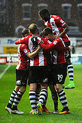 Lloyd James (4) of Exeter City celebrates scoring a goal with his team mates to give a 4-0 lead to the home team during the EFL Sky Bet League 2 match between Exeter City and Crewe Alexandra at St James' Park, Exeter, England on 4 February 2017. Photo by Graham Hunt.