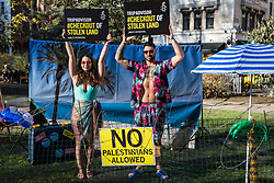 London, UK. 30th January, 2019. Campaigners from Amnesty International UK set up a 'barbed wire beach' outside the headquarters of TripAdvisor as part of a campaign to highlight the fact that the online tourism company arranges holidays in illegal Israeli settlements in the Israeli-occupied Palestinian Territories.