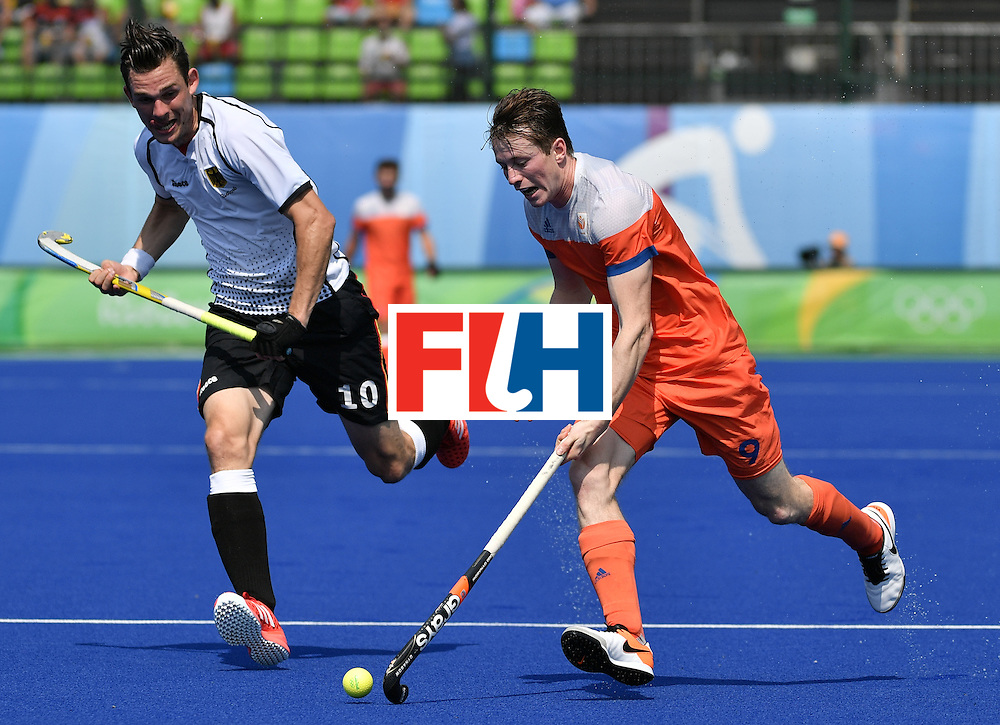 Germany's Christopher Wesley (L) vies with Netherlands' Seve van Ass during the men's Bronze medal field hockey Netherlands vs Germany match of the Rio 2016 Olympics Games at the Olympic Hockey Centre in Rio de Janeiro on August 18, 2016. / AFP / Pascal GUYOT        (Photo credit should read PASCAL GUYOT/AFP/Getty Images)