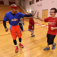 Adam Robison | BUT AT PHOTOS.DJOURNAL.COM<br /> Coach Larry Calhoun, gives a high five to Riley Briley, a fifth grader at Belmont Elementary School, during the Learn to Move program in Belmont Wednesday morning.