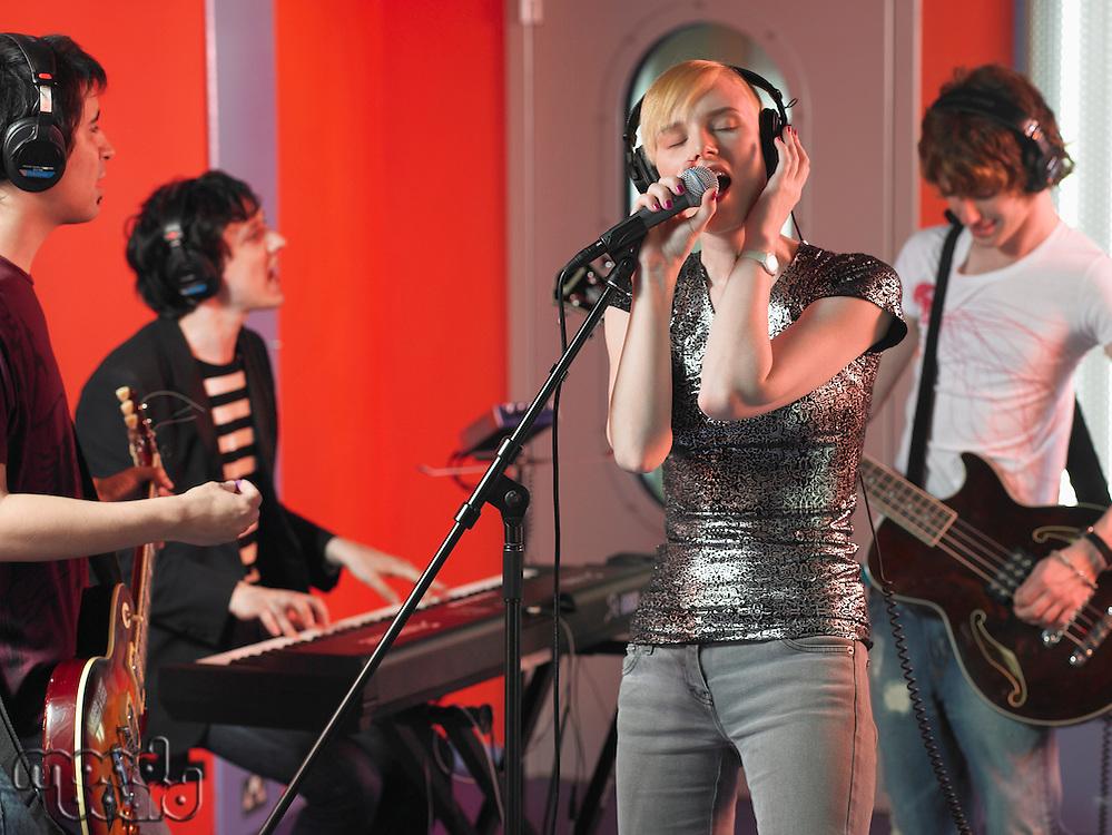 Rock Band Performing in Studio