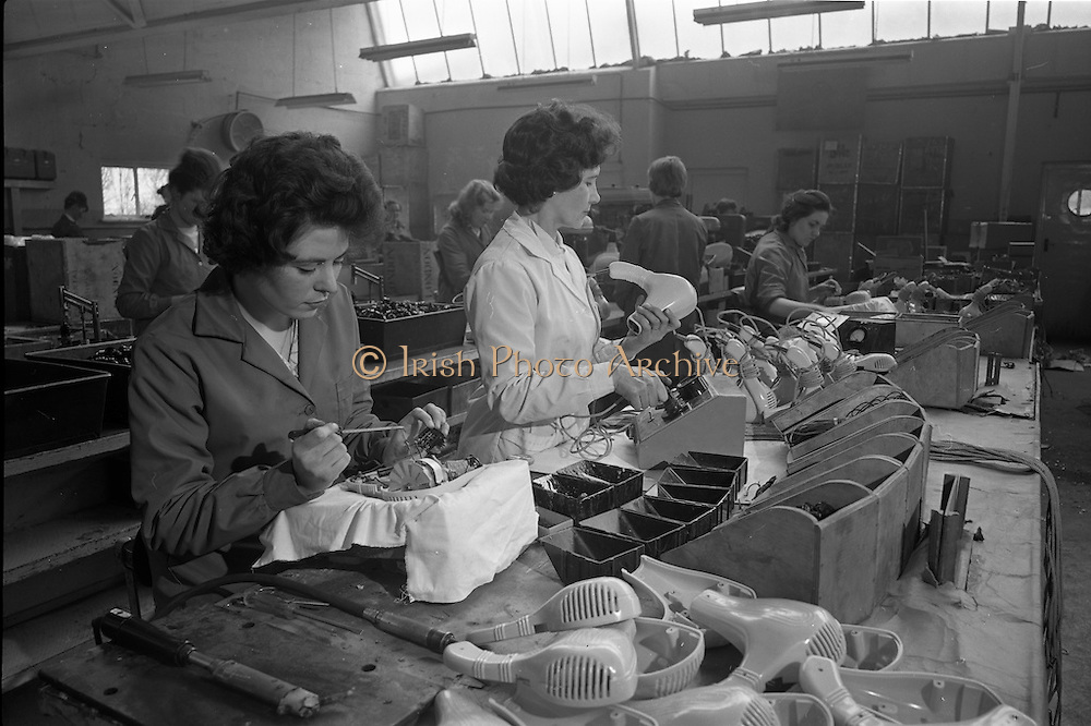 06-10/04/1964.04/06-10/1964.06-10 April 1964.Views on the River Shannon. Mary Cassidyand Elizabeth Moran at work on the assembly of domestic hair dryers, which were amongst many electrical products moulded inplastic at General Plastics Ltd., Carrick-on- Shannon, Co. Leitrim.