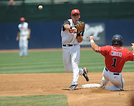 St. John's Matt Wessinger (0) forces out Mississippi's Zach Miller (1) and throws to first for a double play during an NCAA Regional game at Davenport Field in Charlottesville, Va. on Sunday, June 6, 2010.