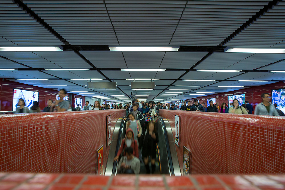 People descending an escalator in Central Station, Hong Kong. (photo by Andrew Aitchison / In pictures via Getty Images)